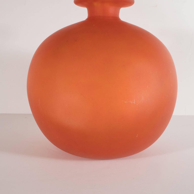 This beautiful Art Deco vase was handblown by Charles Schneider one of the most illustrious glass blowers of the period in France, circa 1930. It features an orbital body with a cylindrical neck that expands outwards to a circular bobeches style