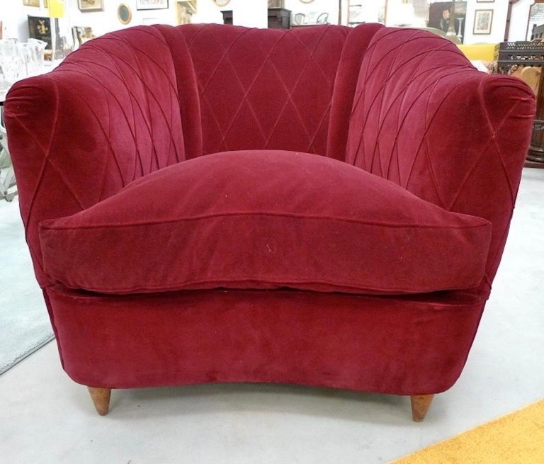Lovely French 1940s upholstered armchair in curved-back form with distinctive croisillon diamond-shaped stitching on the burgundy velvet. 