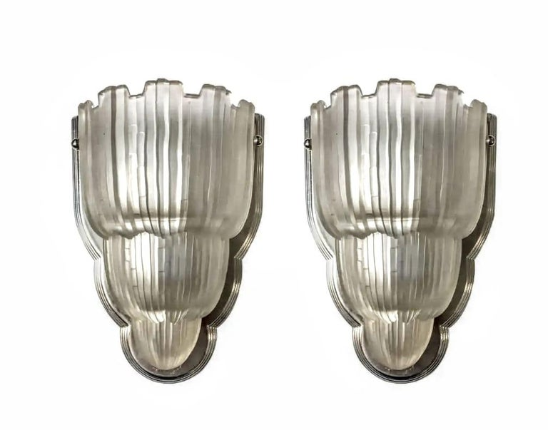 This pair of French Art Deco sconces are known as the
