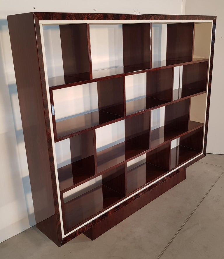 Art Deco bookcase with amazing combination lacquered walnut/walnut burl veneer and white leather covered parts, France, 1940s. Recently restored.