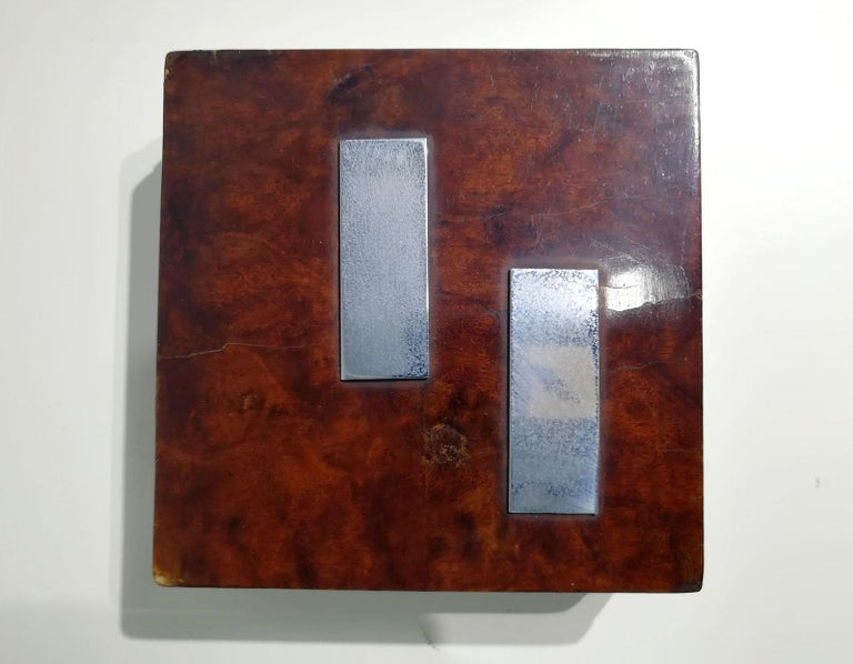 A beautiful wooden square shaped box that has a variety of uses, it can be used as a jewelry or trinkets box on the desk or dressing table or for storing cigarettes and tobacco in.