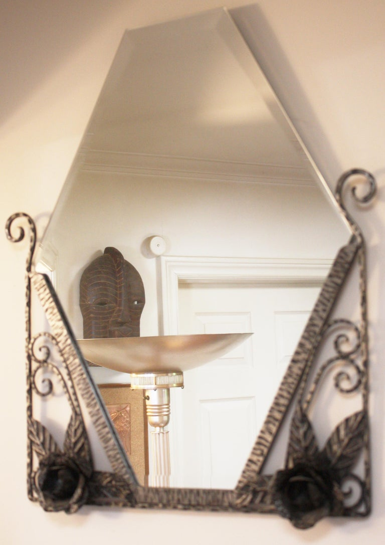 This elegantly executed French hand forged, wrought iron, demi-lune console table and mirror set is crafted in the Art Deco Ferronier Moderne style that was popular in France in the mid 1920s. It is designed to be placed in an entry hall as a