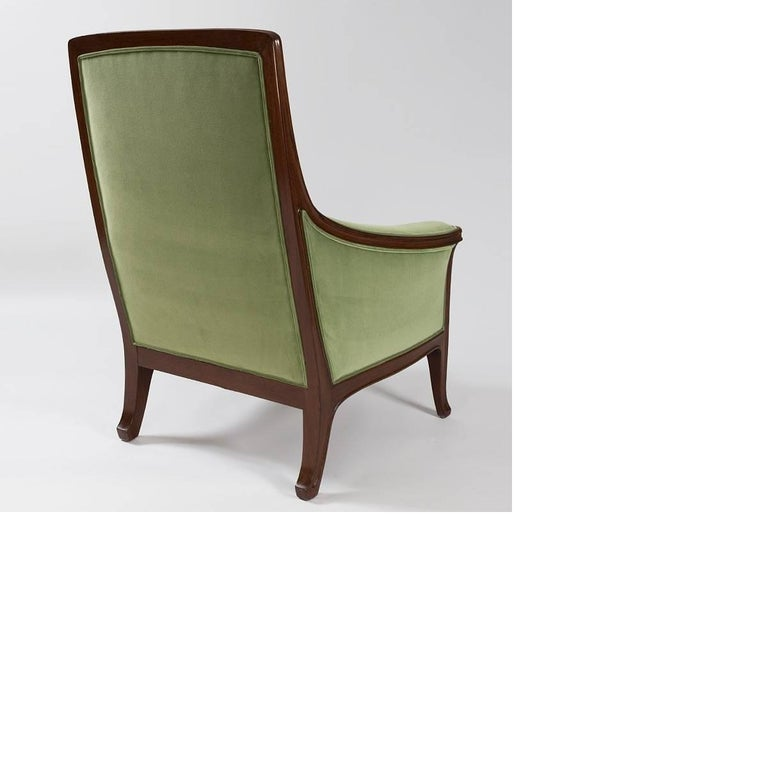 A French armchair by Louis Majorelle. This gracefully-proportioned chair has simple linear carvings on its legs. It is upholstered in green velour.  A similar chair is pictured in: The Paris Salons 1895-1915, Vol. III: Furniture, by Alastair