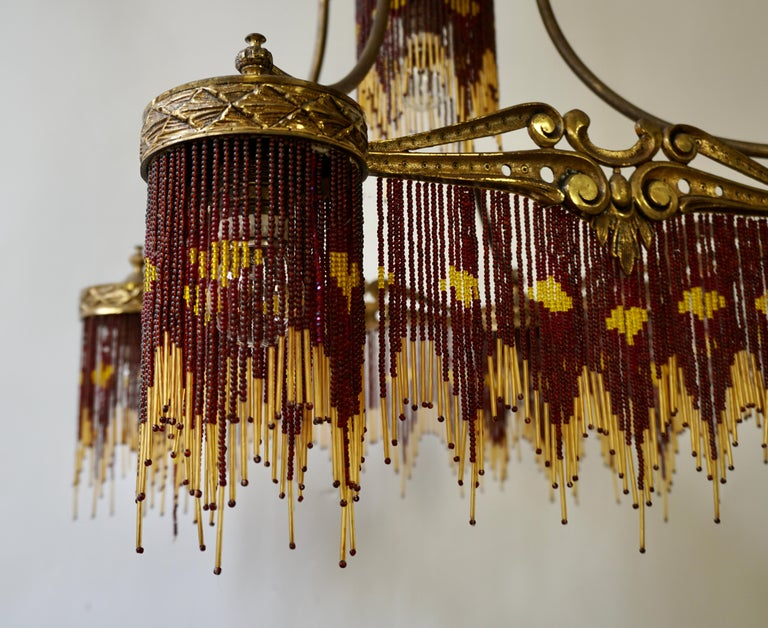 French Art Nouveau and Art Deco Amber Glass Straws Beaded Fringe Chandelier For Sale 7
