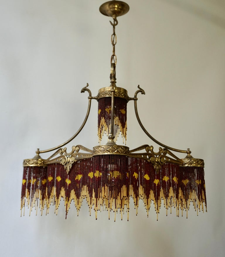 Belgian French Art Nouveau and Art Deco Amber Glass Straws Beaded Fringe Chandelier For Sale