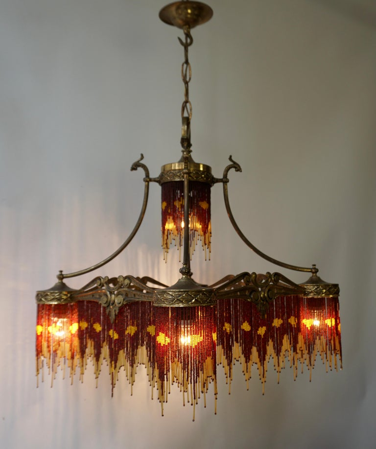 French Art Nouveau and Art Deco Amber Glass Straws Beaded Fringe Chandelier In Good Condition For Sale In Antwerp, BE