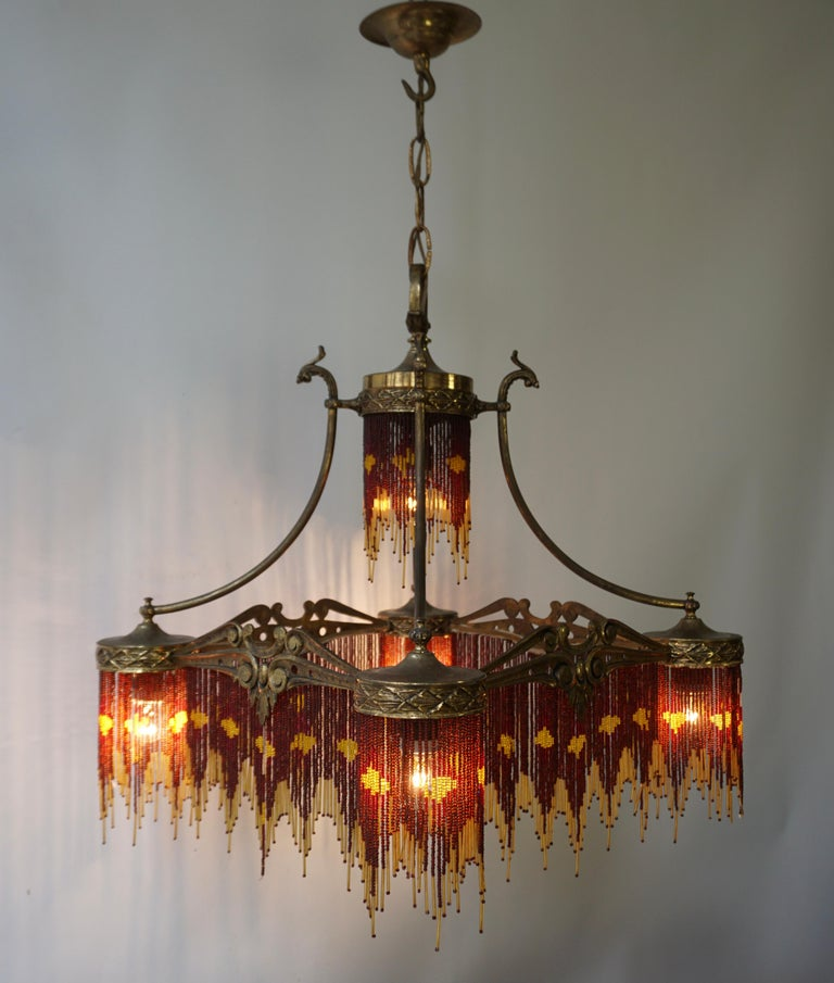 20th Century French Art Nouveau and Art Deco Amber Glass Straws Beaded Fringe Chandelier For Sale