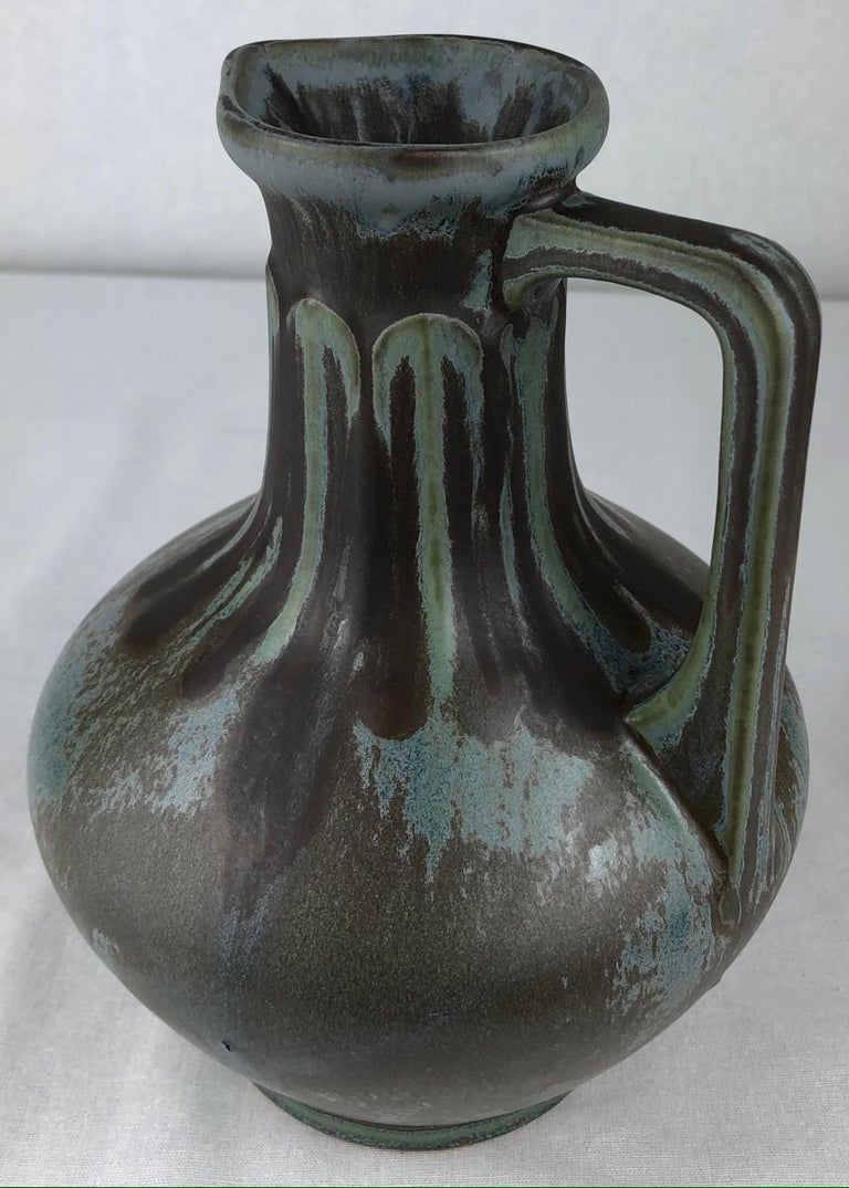 A stunning art nouveau or art deco transition period attributed to French art pottery from La Société Denert et Balichon, known as Denbac Pottery of Vierzon, dating circa 1930.   Denbac's grès flammés (flamed sandstone) glazes are unique to every