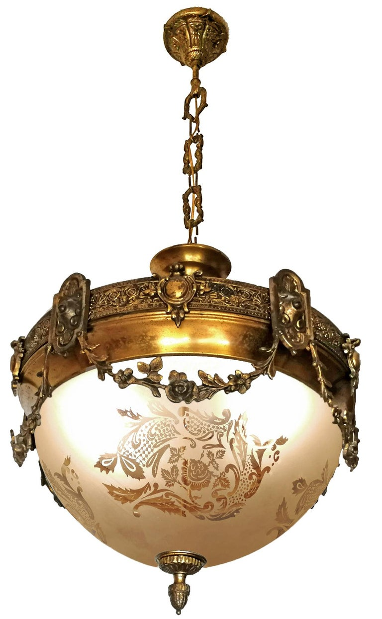 A wonderful gilt bronze and etched-glass two-light ceiling fixture decorated with fine ornaments and garlands, France, early 20th century. In very good condition - original etched-glass shades without damages, bronze with beautiful patina. Two