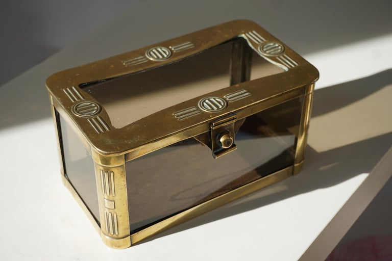 An absolutely splendid French jewelry casket made from brass, retaining the original panels of glass.