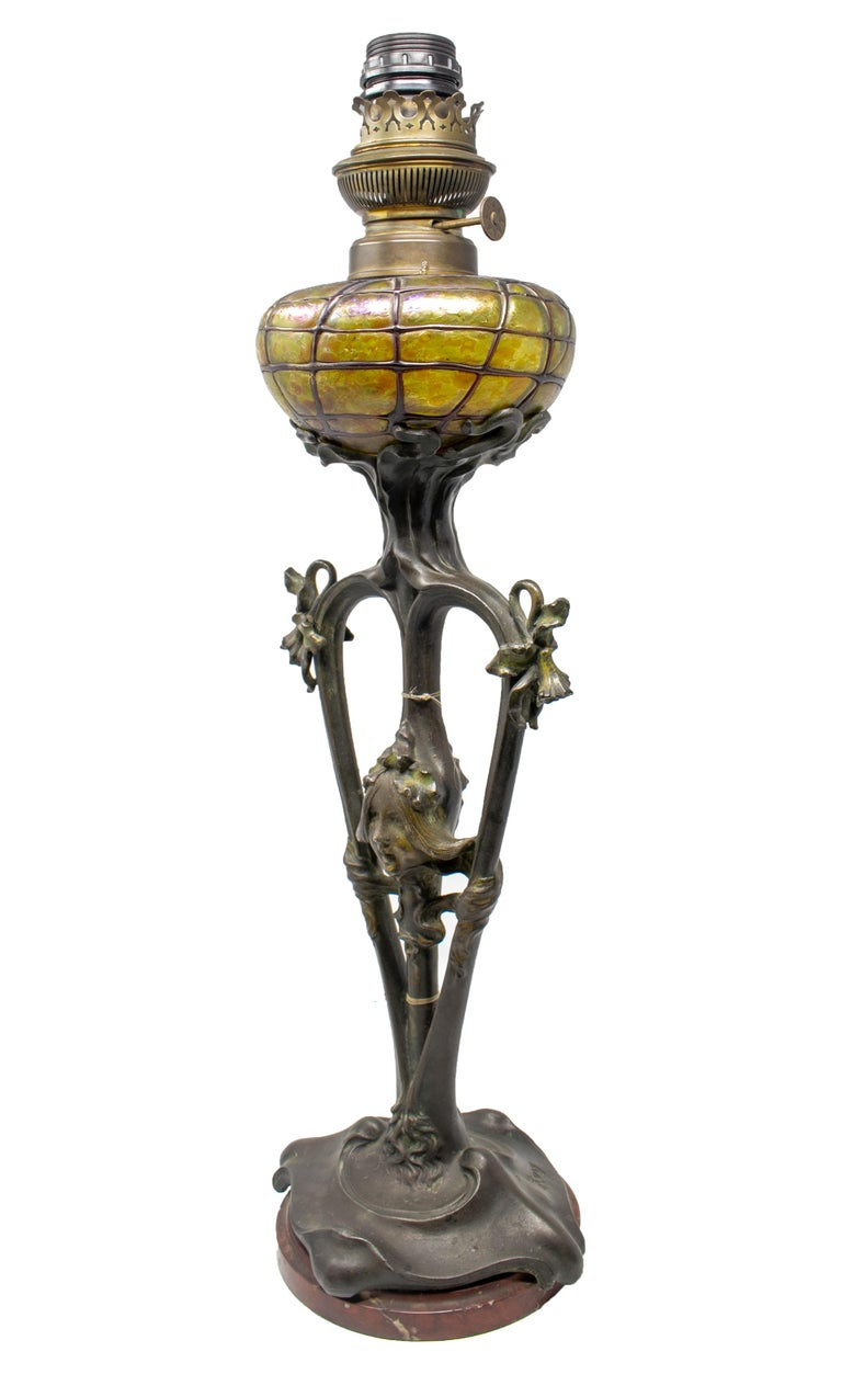 French Art Nouveau bronze and glass lamp signed on the base.