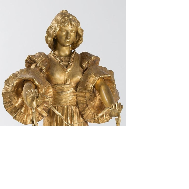 A French Art Nouveau gilt bronze sculpture by Agathon Léonard. This sculpture from the series Jeu de l'echarpe is a rare model featuring a woman with tambourines, circa 1900.