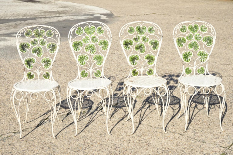 Antique French Art Nouveau Green Flower Maple Leaf Garden Patio Dining Set - 5 Piece Set. Set includes (4) side chairs, (1) dining table, green painted maple leaf frames, shapely legs, ornate flower stretcher base to table, perforated mesh seats,