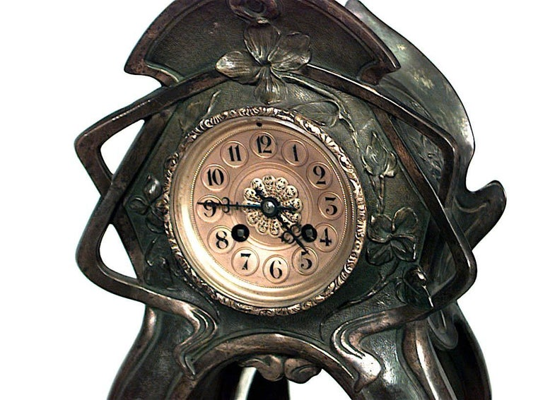 French Art Nouveau metal mantel clock with green patina and mirrored center. (Not working)