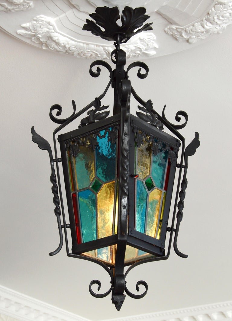 Summer sales. We are renewing our stock waiting for the start of September. Do not wait to order these beautiful pieces. French Art Nouveau stained-glass lantern, France, 1890-1900. Stained-glass and iron. Full height: 25.2