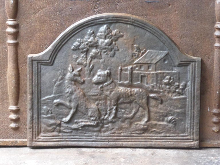 20th century French Art Nouveau fireback with the fable of the wolf and the dog (Jean de la Fontaine 1621-1695). A hungry wolf meets a well-fed dog and compliments him on his good appearance. The dog describes his life of ease and invites the wolf