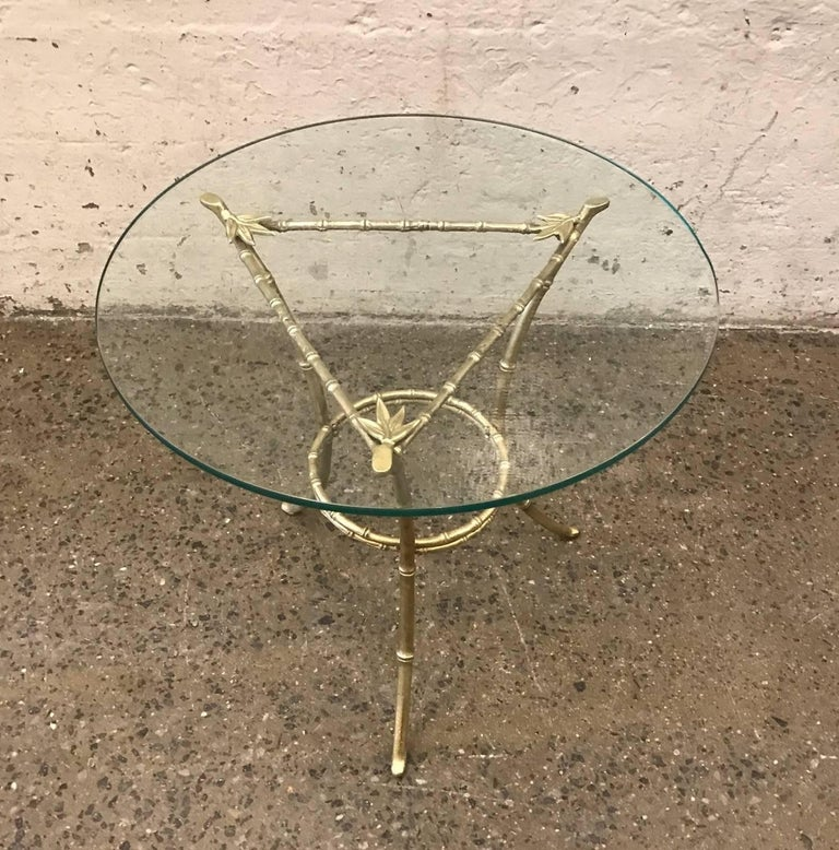 French bronze side table with a faux bamboo pattern and glass top. Style of Maison Baguès.