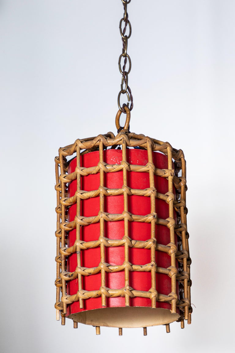 French bamboo lantern pendant with red illuminated paper, antique brass chain and brown twist cord added. The light has been newly wired and comes with a canopy. Lantern alone is 12