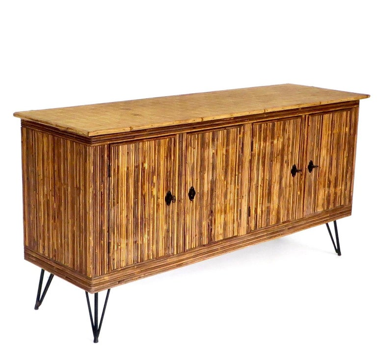 French Bamboo or Split Reed Grass Cloth Topped Four-Door Buffet on Iron Legs In Good Condition For Sale In Chicago, IL