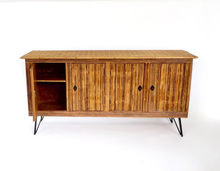 Mid-20th Century French Bamboo or Split Reed Grass Cloth Topped Four-Door Buffet on Iron Legs For Sale