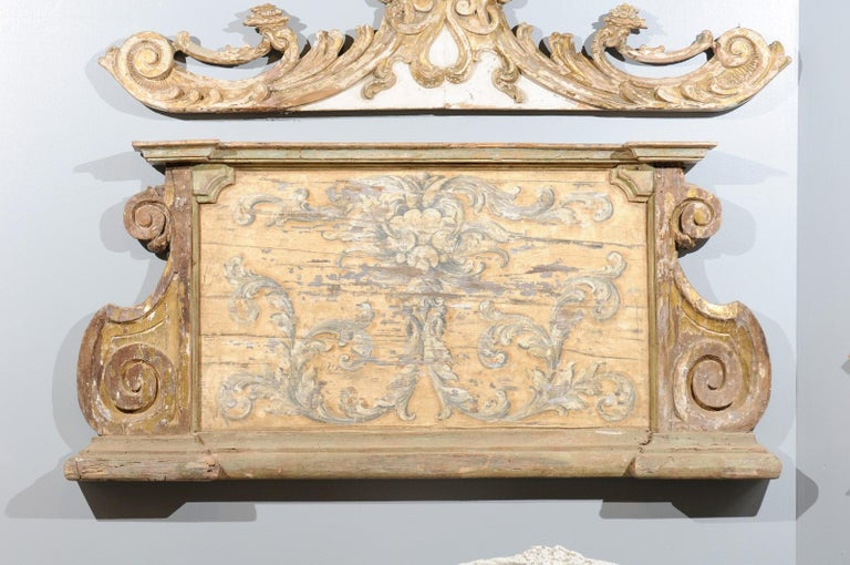 A French Baroque style painted and carved architectural panel from the 19th century, with volutes and painted scrollwork motifs. Born in France during the later years of the 19th century, this exquisite French architectural panel captures our