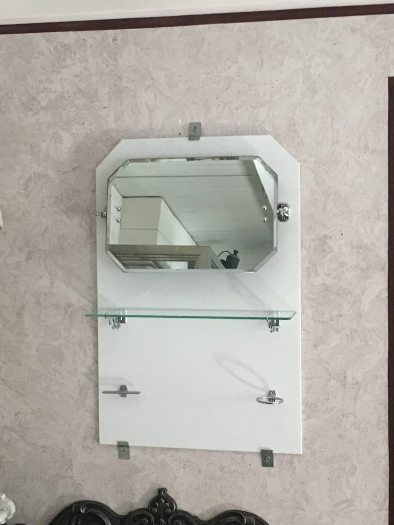 French bathroom adjustable mirror with shelf and accessories from 1920s.