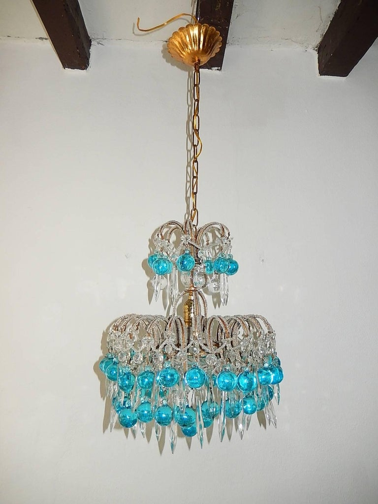 Housing one-light. Three tiers of crystals and rare Murano aqua blue balls. Plate on bottom. Re-wired and ready to hang. Free priority shipping from Italy. Adding another 16 inches of original chain and canopy.
