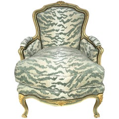 French Bergère Chair, Carved and Painted in Ivory and Celadon Newly Upholstered