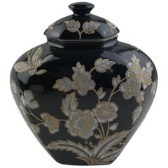 French Black and Antique White Majolica Lidded Jar with Molded Floral Decor
