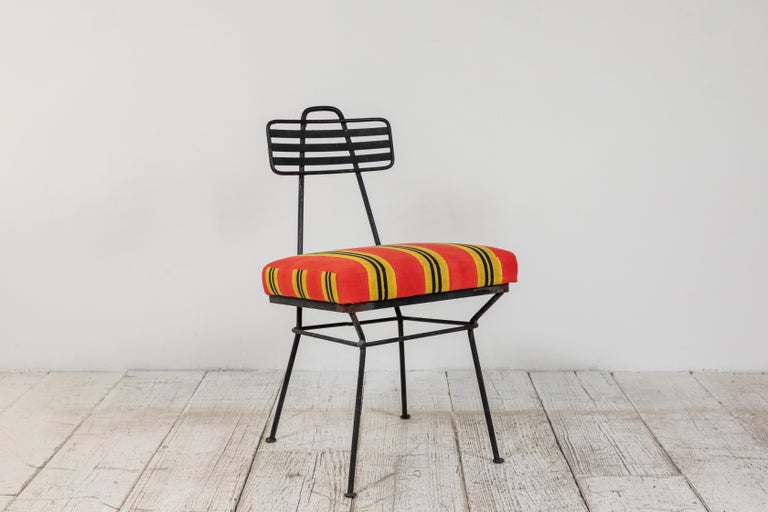 French metal garden chair newly upholstered in a Lisa Corti orange yellow and black canvas.