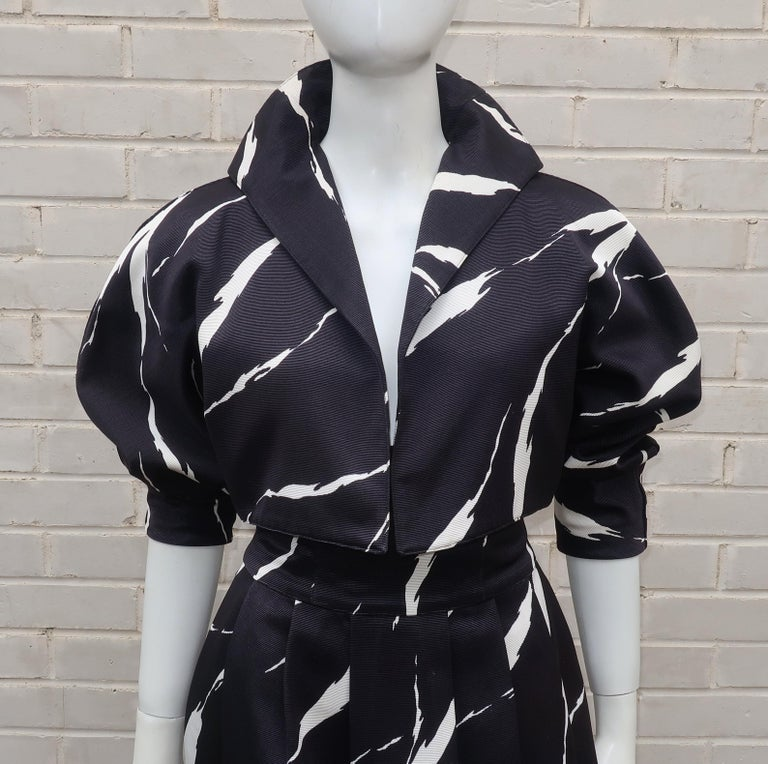 This black and white suit is a fabulous take on 1980's French Riviera glamour.  The faille fabric is a silk and wool blend in an abstract pattern that resembles zebra stripes ... or tiger slashes ... either way it is wonderfully wild especially when
