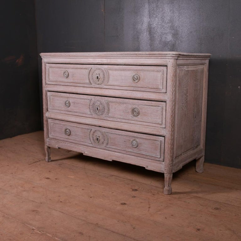18th century bleached oak three-drawer commode, 1790.  Dimensions: 49.5 inches (126 cms) wide 22.5 inches (57 cms) deep 36.5 inches (93 cms) high.