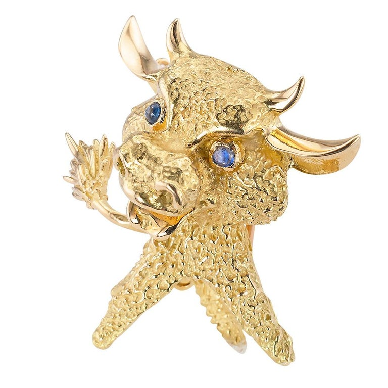 Vintage French blue sapphire set eyes and 18 karat yellow gold whimsical bull clip brooch circa 1970.  Love it because it caught your eye and we are here to connect you with beautiful and affordable jewelry.  Make yourself happy!  Simple and concise