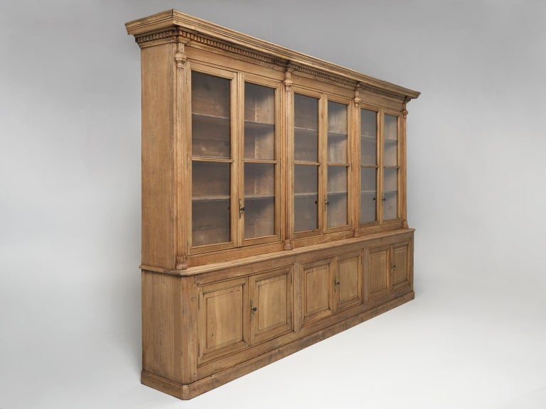 Massive and completely original, unrestored French antique weathered oak bookcase, dating from the mid-1800's. This highly unique antique French bookcase, might have the most beautiful color oak we have ever seen. This is not some finishers