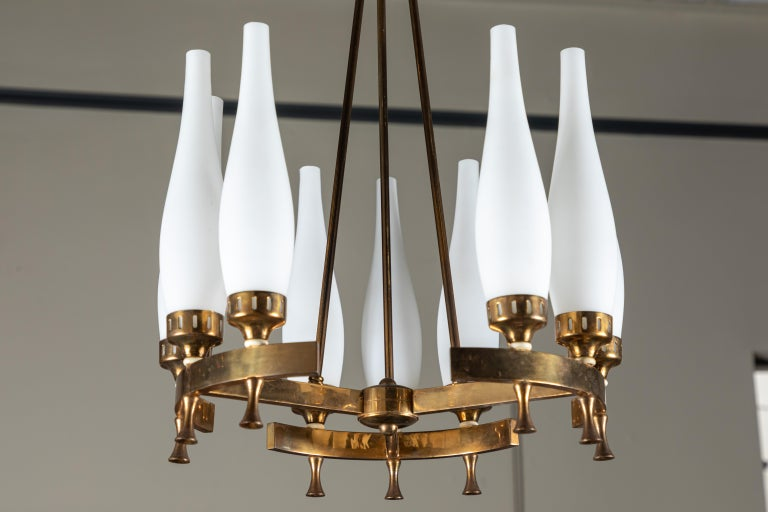 French brass and frosted glass Torlesco chandelier with 9 sockets. The chandelier offers elegant and beautiful details. The chandelier has been newly rewired.