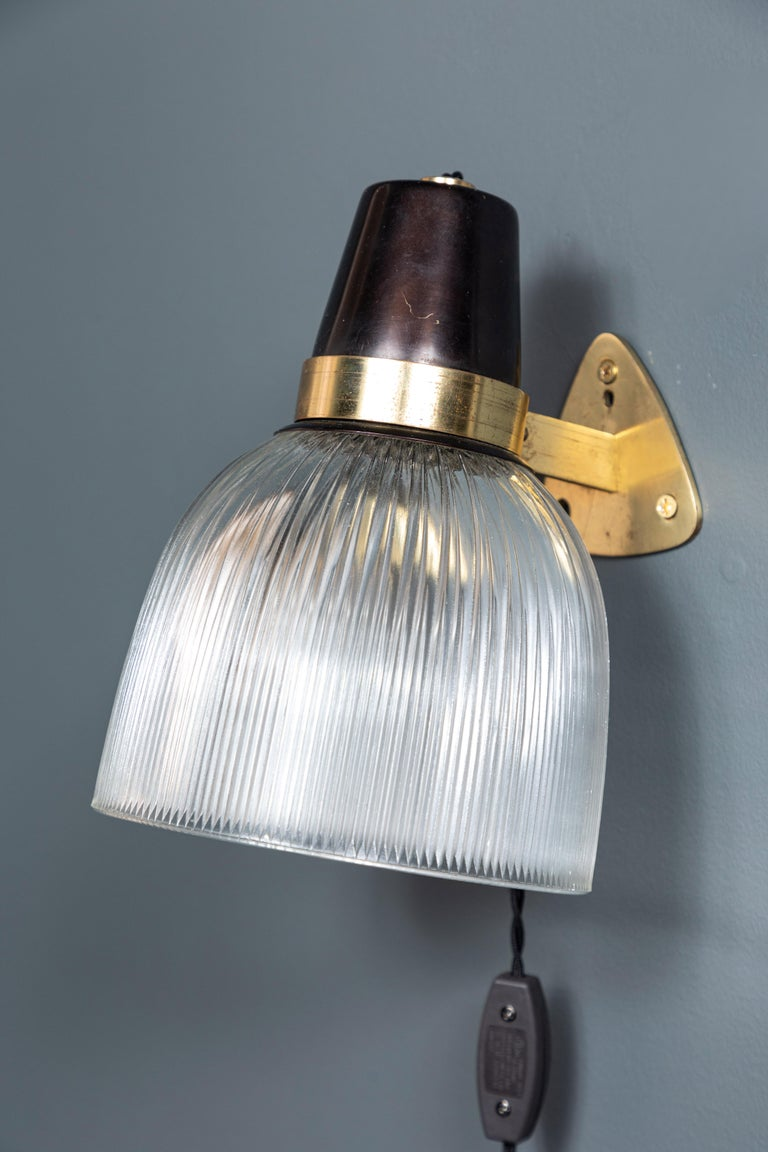 French brass and black sconce with heavy ribbed glass. The sconce is newly re-wired and can be plug in or hard wired. Six sconces are available.