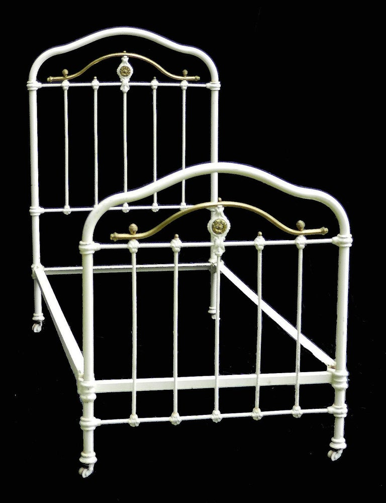 French iron and brass single bed, circa 1890 With brass ring details On original castors This bed will take a 3 foot 6 inch or 45 inch wide mattress on either a slatted wood base (included) or a box base (not included) please ask for more info