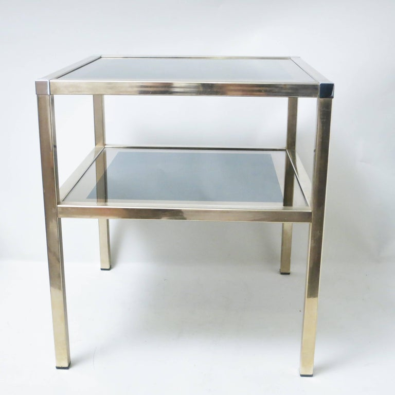 French Mid-Century Modern double level side table in brass, chrome and mirror by Maison Charly Frères in Bordeaux France and in the style on Guy Lefebre for Jansen or Pierre Vandel.