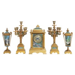 French Bronze and Champleve Cloisonne Enamel Five-Piece Clock Garniture Set