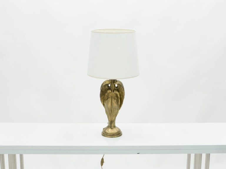 This Art Deco solid bronze lamp has a modernist appeal yet timeless feel. Signature trace on the base. This piece would be ideal for a desk, designed to cast a warm mood around a space. It's a beautiful example of Art Deco decoration. Very heavy,