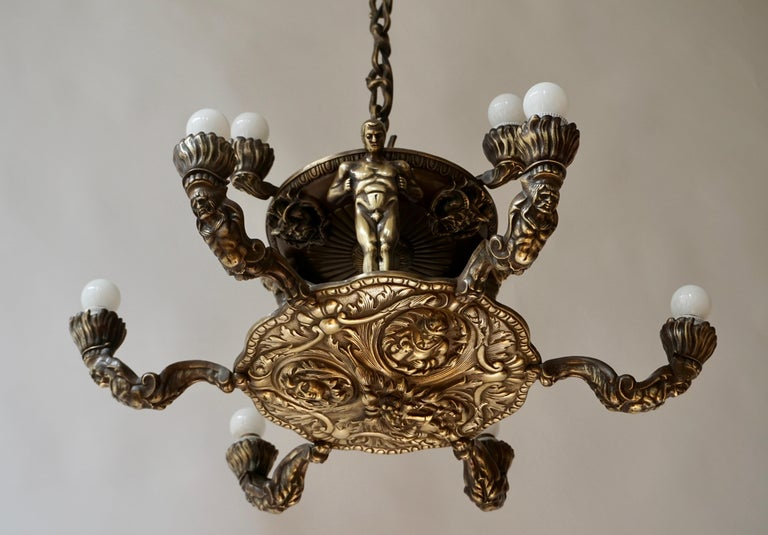 French Bronze Art Deco Hollywood Regency Chandelier Showing Male Nude Figures For Sale 1