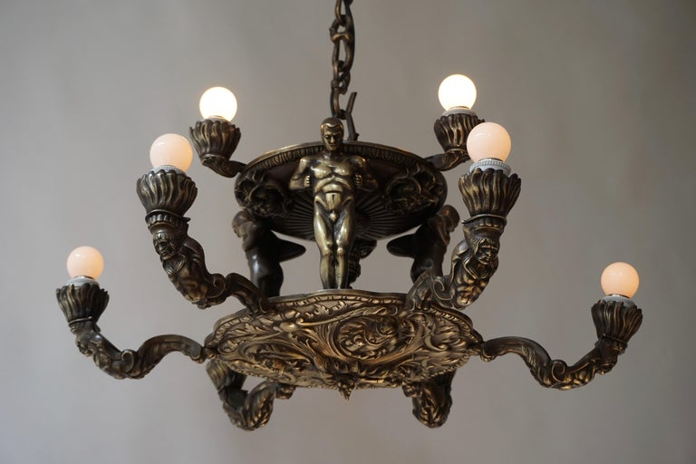 French Bronze Art Deco Hollywood Regency Chandelier Showing Male Nude Figures For Sale 3