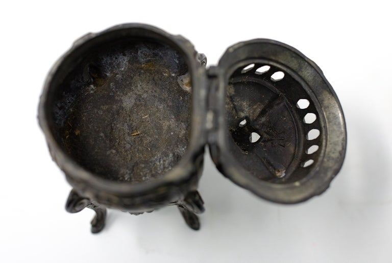 Offering this beautiful bronze censer that is French made. It starts on the bottom on four legs that are cabriole legs and works up to the body of the censer. The underside has a lotus flower and Marked, Made in France. There is a hinged lid that