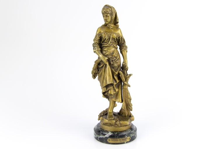 "French bronze figure ""Retour des Champs"" by Eutrope Bouret (1833-1906), impressed signature to rim, raised on marble plinth base, stamp # 1437 E.V.
