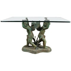 French Bronze Glass Top Garden Table with Pair of Cherubs at the River Bank