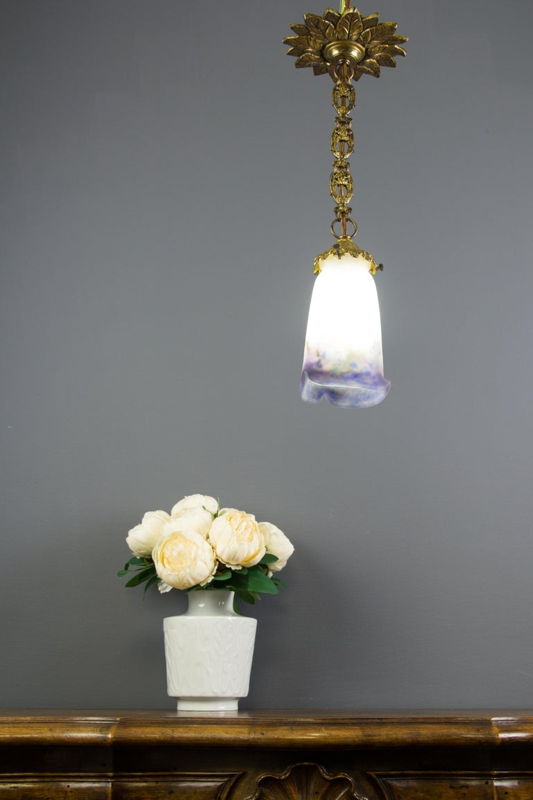 """Adorable bronze pendant light with polychrome """"Pâte de Verre"""" glass shade with purple, blue, green and beige accents and one socket for B22 light bulb with new wiring. The glass lampshade is marked with Muller Freres Luneville. France,"""