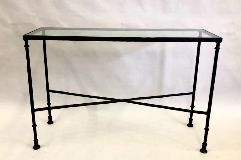 An elegant and timeless French Mid-Century Modern hammered and bronzed wrought iron console / sofa tablein the style of Alberto and Diego Giacometti for the French interior design Luminaire, Jean-Michel Frank. The stunning piece features a