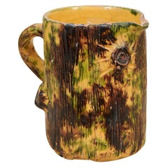 French Brown Glazed Pottery Pitcher with Yellow and Green Textured Accents