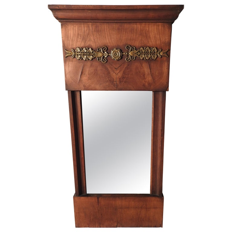 Offering this gorgeous burled wood French wall mirror. The bottom starts just a nice piece of burled wood. Going up from there the sides are the same. At the top is more burled wood and a trim piece and in the center is a long narrow piece of brass