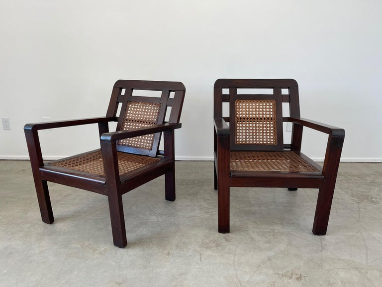 Pair of French caned chairs in geometric open shape with original open circle caning.  Great angular back and dark grain to patina.